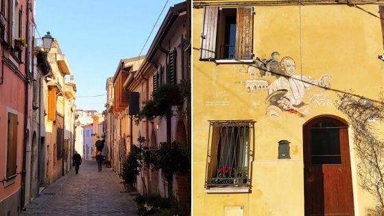Case colori pastello con murales dedicati a Federico Fellini a Borgo San Giuliano, Rimini
